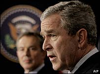 US President George W Bush with UK PM Tony Blair in the background