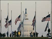 Flags fly at half-mast at the foot of the Washington Monument