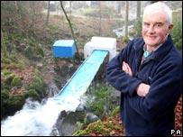 Ian Gilmartin with the mini-waterwheel