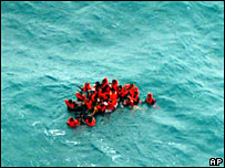Survivors of a ferry accident drift in the sea off Rembang, Indonesia