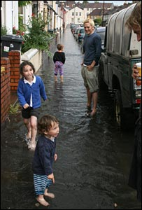 Children playing in floods in Ashton, Bristol (pic Will Raffety)