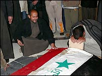 Mourners at the burial site of Saddam Hussein