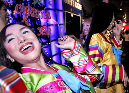 Thai bar hostesses celebrate the arrival of the New Year.