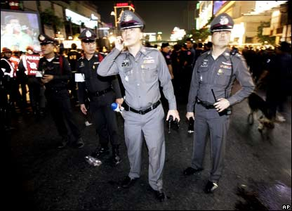 Bangkok police gather near a command post after it was announced that New Year's celebrations in the Thai capital would be cancelled following bomb blasts in Bangkok