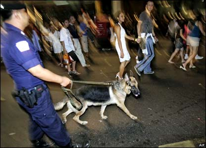 Bangkok police patrol with dogs following an announcement closing New Year's celebrations in the Thai capital in Bangkok