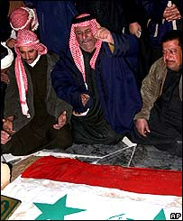 Saddam supporters at his burial site