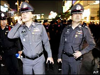 Bangkok police gather after the blasts