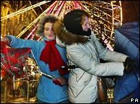 Women struggle with umbrellas in Edinburgh