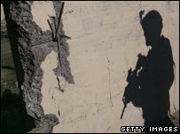 The shadow of a US soldier falls across a wall in the Iraqi capital