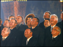 Romanian and EU officials smile during the ceremony as the country becomes a member of the EU