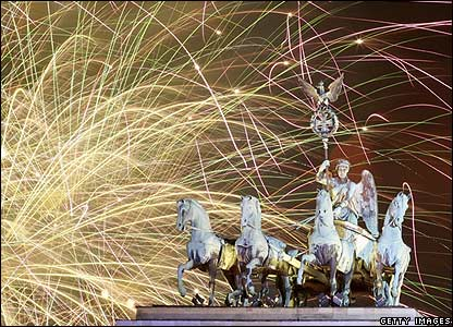 Fireworks light the sky above the Quadriga at the Brandenburg Gate in Berlin