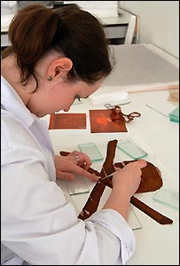 Student Bonnijo Chervenock restoring the flag - copyright University of Southampton