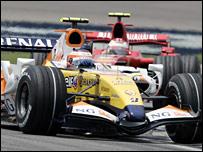 Renault's Heikki Kovalainen holds off Ferrari's Kimi Raikkonen