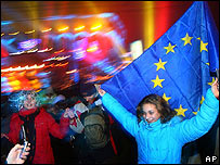 A Romanian holds an EU flag at a New Year party in Bucharest