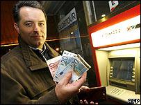 A Slovene man withdraws euros