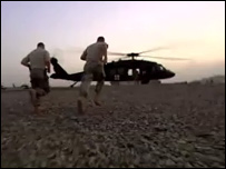 Medics run towards a helicopter in Afghanistan