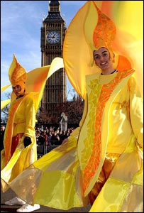 Men in yellow costumes take part in the New Year's Day Parade