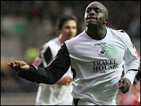 Swansea striker Adebayo Akinfenwa celebrates the opening goal