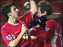 Matt Derbyshire (left) celebrates his first goal for Blackburn