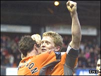 Barry Robson celebrates his goal against Falkirk