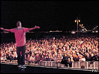 Fatboy Slim, aka Norman Cook, and crowds at the Big Beach Boutique 3 gig in Brighton
