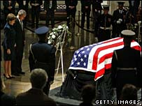 Laura and George Bush pay their respects by the coffin
