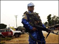 UN peacekeeper holding a gun