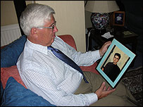 Albert Elphick with a photograph of his youngest son (picture from Surrey Police)