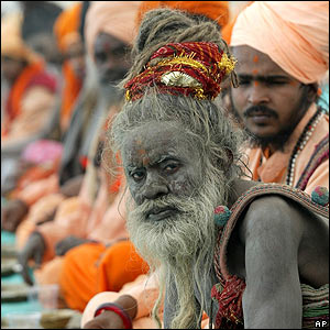 A Naga Sadhu, or Hindu holy man, waits for his food before the start of their procession toward Sangam in Allahabad