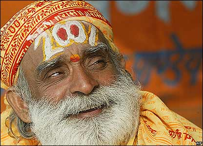 An Indian Sadhu, Hindu holy man, sports a 'tilak' on his forehead with the letters 2007 to mark New Year in Allahabad