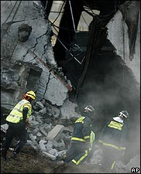 Rescuers search the rubble of Barajas airport car park
