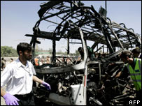 A man beside the wreckage of a bombed bus in Kabul, Afghanistan (17 June 2007)
