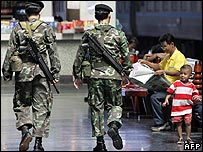 Thai soldiers patrol a railway station in Bangkok on 2 January 2007