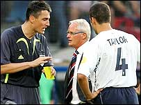 Holland coach Foppe de Haan (centre) asks the referee to make Steven Taylor take a penalty
