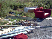 Furniture and rubbish by the roadside