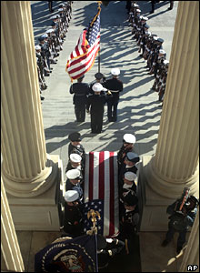 Former President Gerald Ford's casket is carried from the US Capitol en route to the Washington National Cathedral in Washington on Tuesday