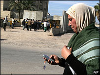 Woman uses a mobile phone in Baghdad, November 2006