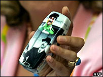 Mobile phone cover bearing Saddam's image