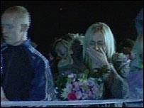 Ellie Lawrenson's family leave flowers outside the house where she died