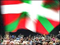 Marchers waving Basque flag