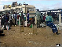 Zimbabweans at a bus station