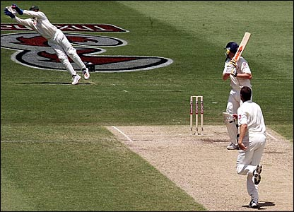 Australia's Adam Gilchrist (left) takes the catch to dismiss Andrew Flintoff (centre)
