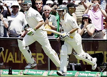 Australia openers Matthew Hayden (left) and Justin Langer run onto the pitch