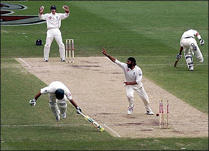 Ricky Ponting (left) tries to make his ground as England bowler Monty Panesar (centre) appeals for the run out