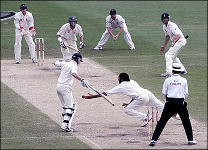 Monty Panesar (bottom centre) attempts to stop a shot from Michael Hussey