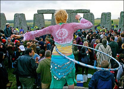 A girl hula hoops within the stones