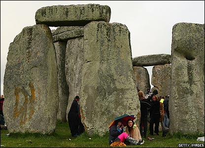 Some visitors shelter amongst the stones