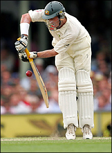 Michael Hussey plays a defensive shot
