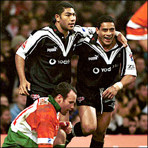 Vainikolo celebrates a try against Wales with team-mate Willie Talau at the 2000 World Cup