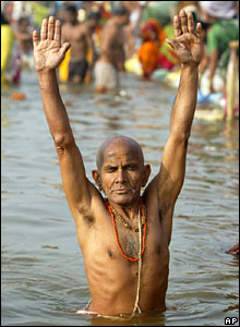 A faithful prays after taking a dip at the Ardh Kumbh Mela in Allahabad
